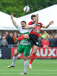 NEWTOWN, WALES - Saturday, May 2, 2015: The New Saints' Kai Edwards in action against Newtown's Jason Oswell during the FAW Welsh Cup final match at Latham Park. (Pic by Ian Cook/Propaganda)