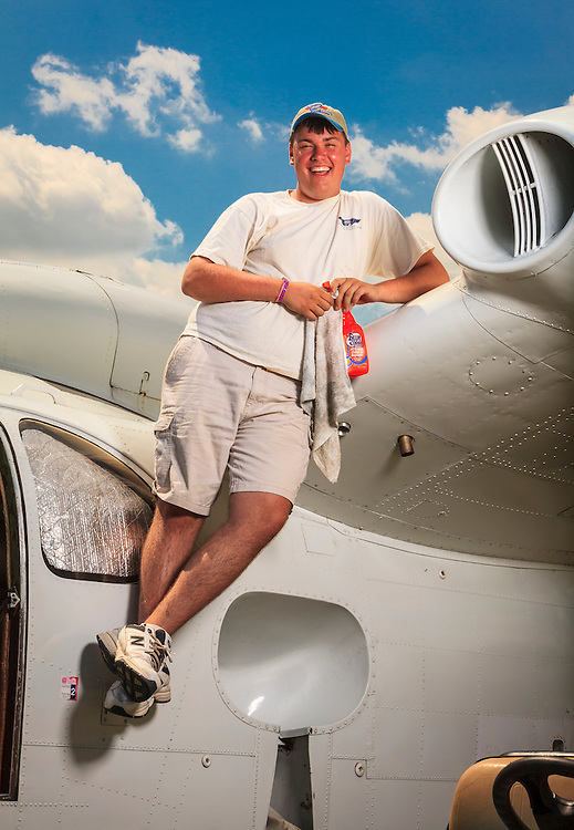 Billy Janus takes a break from cleaning airshow performer John Mohr's Piaggio P. 136 L1 seaplane during AirVenture 2012.