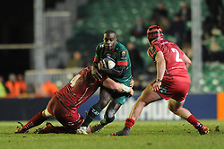 Leicester Tigers winger, Miles Benjamin is tackled by Scarlets lock, Jake Ball - Photo mandatory by-line: Dougie Allward/JMP - Mobile: 07966 386802 - 16/01/2015 - SPORT - Rugby - Leicester - Welford Road - Leicester Tigers v Scarlets - European Rugby Champions Cup