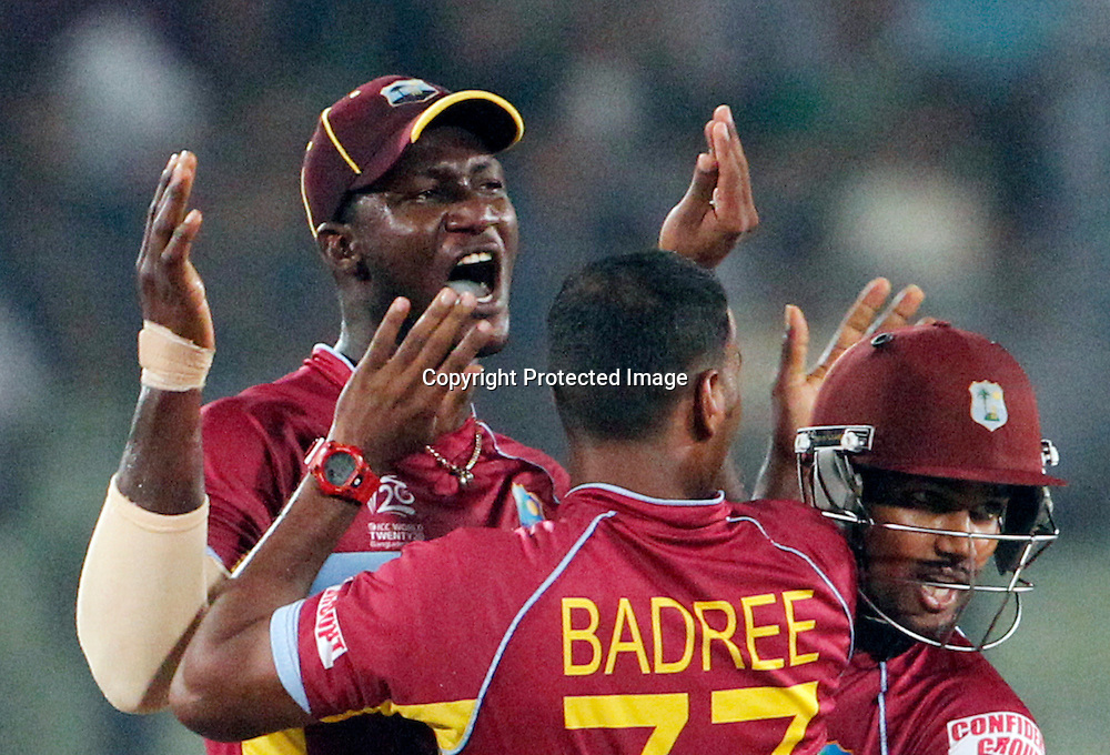 Darren Sammy celebrates the wicket of Kumar Sangakkara, T20 Cricket World Cup, Semi Final, Sri Lanka v West Indies, Sher-e-Bangla National Cricket Stadium, Mirpur, Bangladesh, 3 April 2014. Photo: www.photosport.co.nz