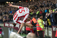 Football - 2017 / 2018 Premier League - West Ham United vs Stoke City<br /> <br /> Peter Crouch (Stoke City) leaps the barrier to celebrate with his teams fans  at the London Stadium<br /> <br /> COLORSPORT/DANIEL BEARHAM