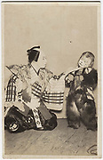 Kabuki actors with child in a monkey costume, 1920s, silver gelatin bromide.<br />