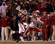 University of Oklahoma defensive back Marcus Walker (24) brakes up a pass intended for Nebraska wide receiver Terrence Nunn (83) in the first quarter during the Big 12 Championship game at Arrowhead Stadium in Kansas City, Missouri, December 2, 2006.  The Sooners lead at half 14-7.<br />