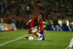 BELGRADE, SERBIA & MONTENEGRO - Wednesday, August 20, 2003: Wales' Mark Delaney is tackled by Serbia & Montenegro's Zvonimir Vukic during the UEFA European Championship qualifying match at the Red Star Stadium. (Pic by David Rawcliffe/Propaganda)