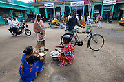 Women selling iddli for morning breakfast on the square outside the entrance to the shrine. Dargha shrine in Nagore.