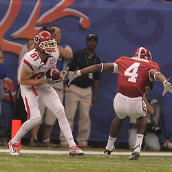 2 January 2009: Utah wide receiver Bradon Godfrey (81) catches a touchdown pass behind Alabama defensive back Mark Barron (4) during the 75th annual All State Sugar Bowl  between the Utah Utes and the Alabama Crimson Tide at the Louisiana Superdome in New Orleans, LA.