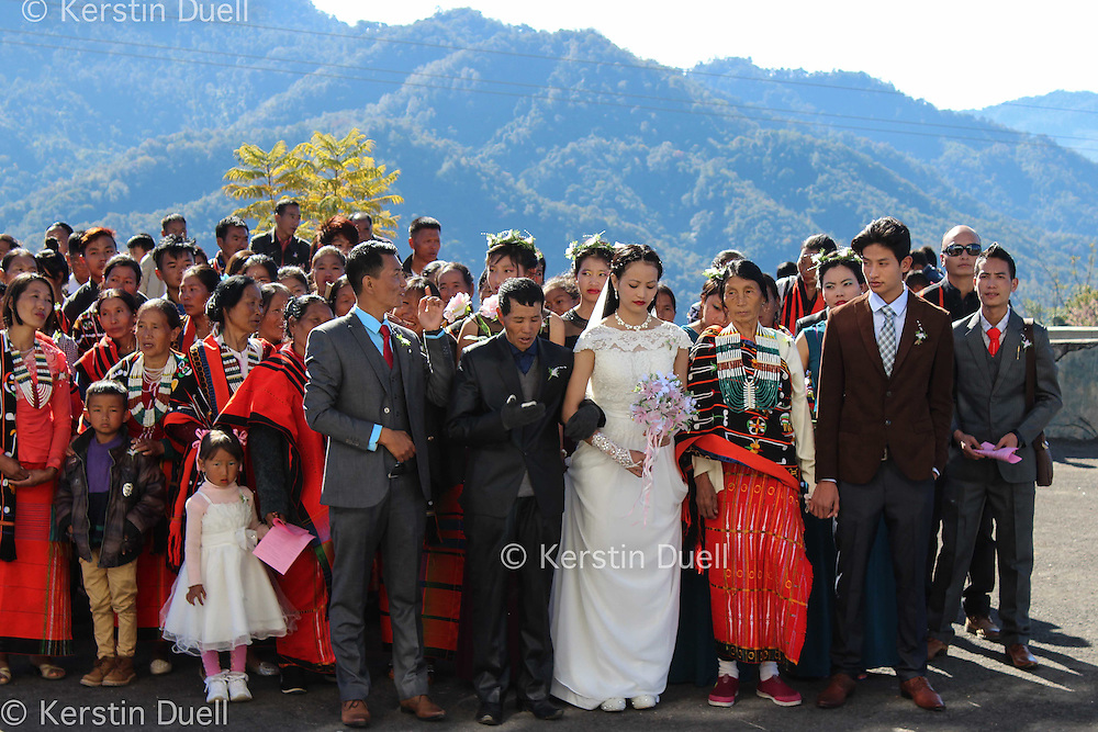 the bride on the way to Shirui Baptist Church on the hill