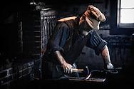 USA, Washington, Fort Vancouver National Historic Site, blacksmith demonstration.