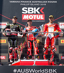 February 25, 2018 - Melbourne, Victoria, Australia - British rider Jonathan Rea (#1) of Kawasaki Racing Team, Italian rider Marco Melandri (#33) of Aruba.it Racing - Ducati and Spanish rider Xavi Fores (#12) of Barni Racing pose for a photo after second race on day 3 of the opening round of the 2018 World Superbike season at the Phillip Island circuit in Phillip Island, Australia. (Credit Image: © Theo Karanikos via ZUMA Wire)