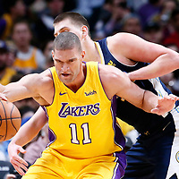 09 March 2018: Los Angeles Lakers center Brook Lopez (11) posts up Denver Nuggets center Nikola Jokic (15) during the Denver Nuggets125-116 victory over the Los Angeles Lakers, at the Pepsi Center, Denver, Colorado, USA.