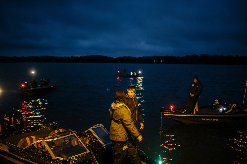 Teams, including Tyler Sheppard, left, and Tyler Branca, center, from Slippery Rock University, wait for the announcer to call their boat to the starting line during the FLW College Fishing Northern Conference Invitational in Marbury, MD on Oct. 11, 2014. Only the top 15 of 43 teams moved on to Sunday.