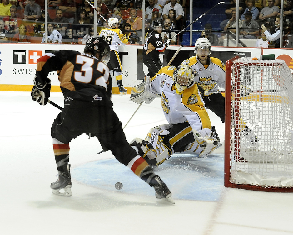 Cody Beach of the Calgary Hitmen corrals a loose puck in Game 6 of the 2010 MasterCard Memorial Cup in Brandon, MB on Wednesday May 19, 2010. Photo by Aaron Bell/CHL Images