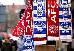 Scarves for sale outside the ground ahead of the Premier League match at the Emirates Stadium, London