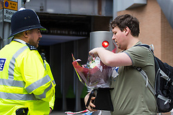 London, June 4th 2017. A man arrives with flowers during a massive policing operation in the aftermath of the terror attack on London Bridge and Borough Market on the night of June 3rd which left seven people dead and dozens injured