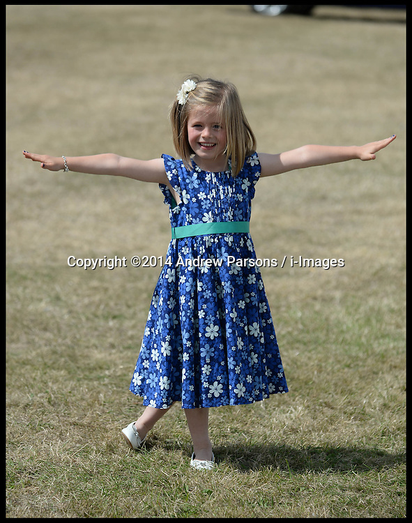 Image ©Licensed to i-Images Picture Agency. 30/07/2014. Norfolk, United Kingdom. Five year old Hollie Ford was given the honour of presenting the Duchess of Cornwall with a posy on her arrival so the little girl practiced her curtsey beforehand as Prince Charles and The Duchess of Cornwall visit the Sandringham Flower show on the Queen's Sandringham estate, Norfolk. Picture by Andrew Parsons / i-Images