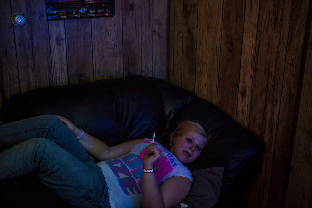 Aimee Jo Kelly lays on a chair during a party on Saturday, November 17, 2012 in Webster City, IA.