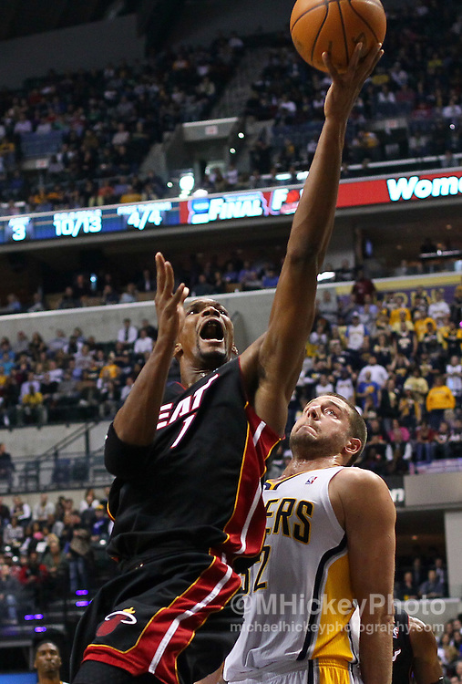 Feb. 15, 2011; Indianapolis, IN, USA; Miami Heat power forward Chris Bosh (1) shoots over Indiana Pacers forward Josh McRoberts (32) at Conseco Fieldhouse. Mandatory credit: Michael Hickey-US PRESSWIRE