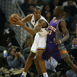 David West #30 drives to the basket as he is defended by Linton Johnson #43 on February 26, 2008 at the New Orleans Arena in New Orleans, Louisiana. The New Orleans Hornets defeated the Phoenix Suns 120-103.