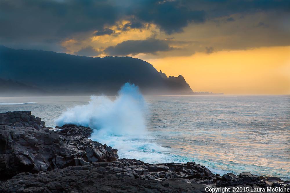 Sunset at Queen's Bath Kauai Hawaii Wave crashing on rocks