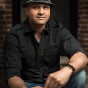 May 12, 2017 - New York, NY : Syed Ali poses for a portrait on the front stoops of his apartment building in Bay Ridge, Brooklyn on Friday afternoon, May 12. Syed, who is a combat veteran with the United States Army and an officer with the New York Police Department, was detained at John F. Kenney Airport earlier this year when he returned from vacation overseas after his most recent deployment -- this despite having his Military ID and US Passport.  CREDIT: Karsten Moran for The New York Times