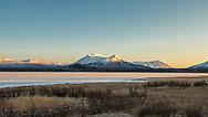 Sunset on the Coast Mountains and Dezadeash Lake in the Yukon Territory in Canada. Winter.