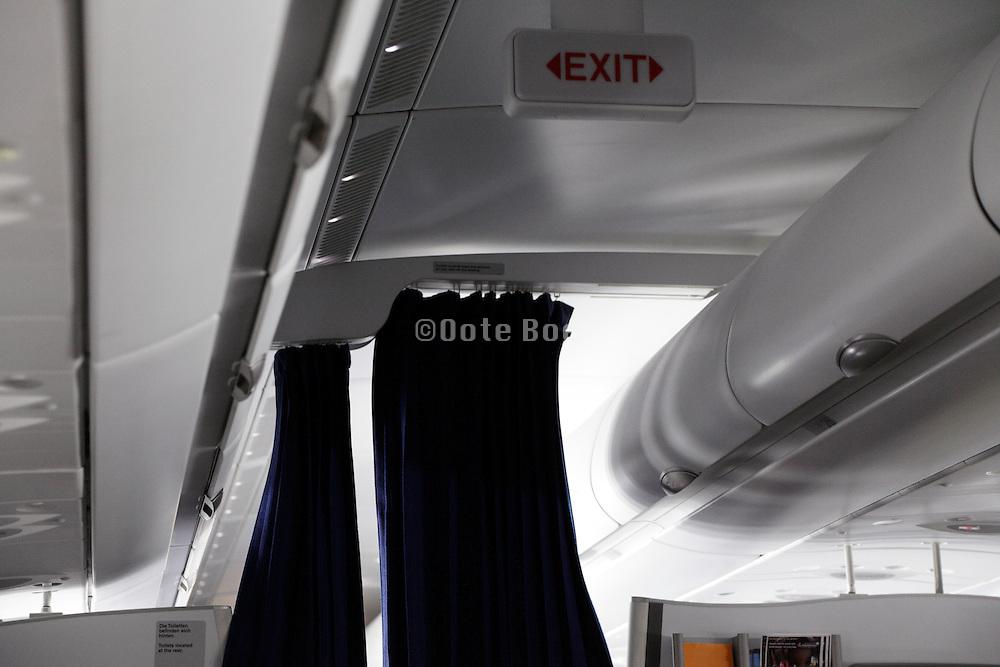 class separation curtain inside a passenger airplane