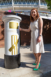 Jenny Smith, Head of Marketing for the ECB poses with the white-painted postbox as Royal Mail unveils a postbox outside Lords Cricket Ground with a plaque and graphics that celebrate England's ICC Cricket World Cup Victory. London, July 16 2019.