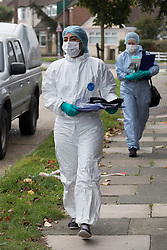 © Licensed to London News Pictures. 03/10/2017. LONDON, UK.  Police officers and forensics in Hood Road in Rainham. Police were called to an address in Hood Road, Rainham at around 11:30 on Monday 2nd  October, where they found the body of a 51 year old man, who was pronounced dead at the scene. A murder investigation has been launched and a 46 year old man arrested. Photo credit: Vickie Flores/LNP