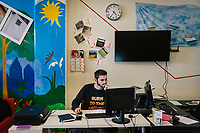"""NAPLES, ITALY - 16 MARCH 2018: Secreatry Pietro Esposito (21) is seen here at work at """"Il Tappeto di Iqbal"""" (Iqbal's carpet), a non-profit cooperative in Barra, the estern district of Naples, Italy, on March 16th 2018.<br /> <br /> Il Tappeto di Iqbal (Iqbal's Carpet) is a non-profit cooperative founded in 2015 and Save The Children partner since 2015 that operates in the Naple's eastern neighborhood of Barra children in the arts of circus, theater and parkour. It was named after Iqbal Masih, a Pakistani boy who escaped from life as a child slave and became an activist against bonded labor in the 1990s.<br /> Barra, which is home to some 45,000 people, has the highest rate of school dropouts in the Italian region of Campania. Once a thriving industrial community, many of the factories were destroyed in a 1980 earthquake and never rebuilt. The resulting de-industrialization turned Barra into a poor, decaying neighborhood. There are no cinemas, theaters, parks or public spaces in Barra.<br /> The vast majority of children from poor families are faced with the choice of working in the black economy or joining the ranks of the organised crime.<br /> Recently, Save the Children Italy opened a number of educational and social spaces in Barra. The centers, known as Punti Luce, or points of light, aim to help local kids stay out of the ranks of the organised crime and have also become hubs for Iqbal's Carpet to work."""
