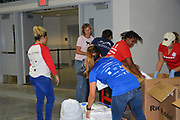 Volunteers at Delmar Stadium receive and sort donations for HISD students after Hurricane Harvey.