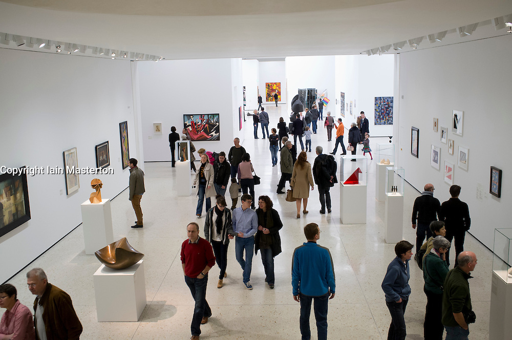 Many visitors to a new contemporary  art museum or GEGENWARTSKUNST at Stadel museum in Frankfurt Germany
