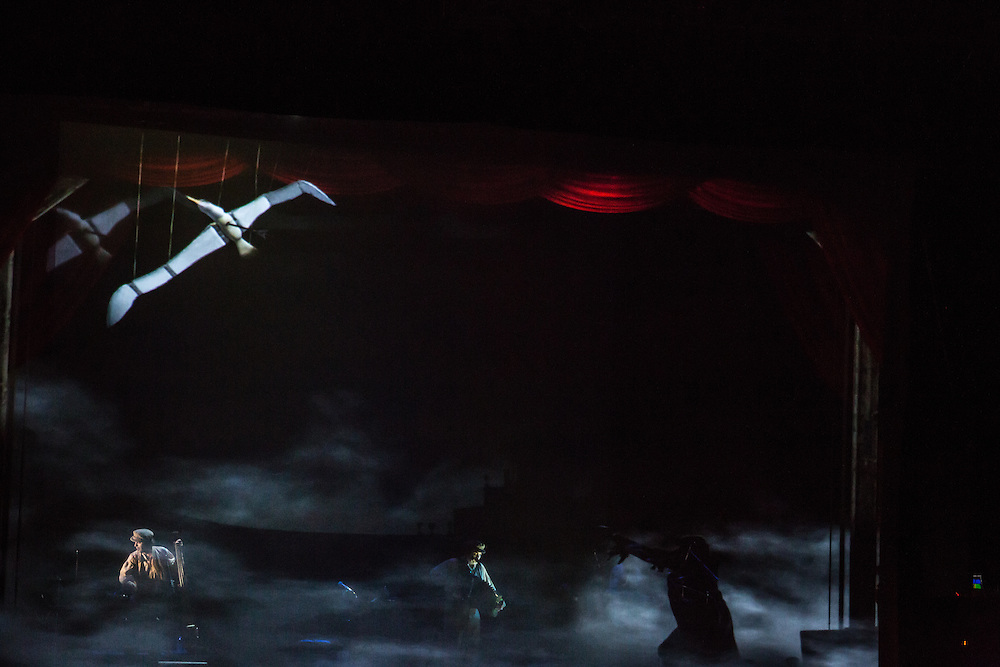 An albatross is about to be killed by the AAncient Mariner. Th eTiger Lillies performance included projected multimedia on front and back scrims.