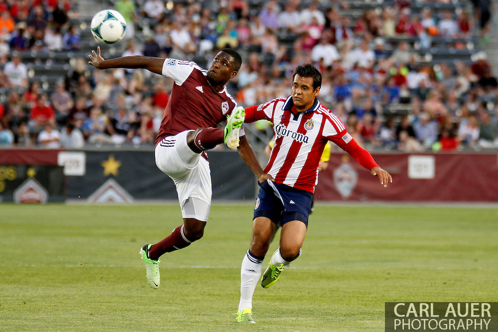 May 25th, 2013 Commerce City, CO - Colorado Rapids forward Edson Buddle (9) attempts to collect a pass as he grabs the shorts of Chivas USA defender Mario de Luna (3) in the first half of action in the MLS match between Chivas USA and the Colorado Rapids at Dick's Sporting Goods Park in Commerce City, CO