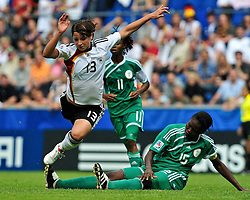 01.08.2010, , Bielefeld, GER, FIFA U-20 Frauen Worldcup, Deutschland vg Nigeria, im Bild Joy JEGEDE (Delta Queens NGA #15) holt Sylvia ARNOLD (FF USV Jena #13) von den Beinen, EXPA Pictures © 2010, PhotoCredit: EXPA/ nph/  Roth+++++ ATTENTION - OUT OF GER +++++ / SPORTIDA PHOTO AGENCY