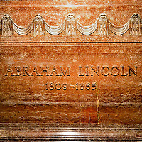 Abraham Lincoln's Burial Room Tomb in Springfield, Illinois<br /> This marble sarcophagus is part of the Lincoln Tomb in Oak Ridge Cemetery in Springfield, Illinois.  Outside is a massive monument with bronze sculptures and a 117 foot obelisk.  Inside is a beautiful rotunda with a Lincoln Memorial statue replica plus symbolism of previous presidents and 36 states at the time of his death in 1865.  An ornate corridor, which leads to the burial room, is decorated with eight Lincoln sculptures plus his famous speeches.  He rested in this cenotaph for two years but, after a foiled attempt to steal his body, he was moved to a vault beneath the floor.
