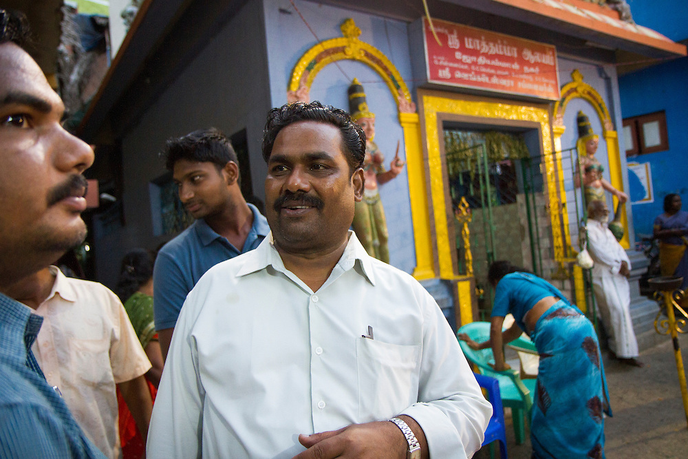 Dr. Gollapalli Israel, director of Janodayam, talks with residences in a slum in Saidapet, Chennai, India.  Dr. Israel is a member of the Dalit caste himself, born into extreme poverty in Chennai.  His passion for making sure that the Dalit communities continue to rise in India has led him to continue his work at Janodayam despite many other lucrative offers he has received.