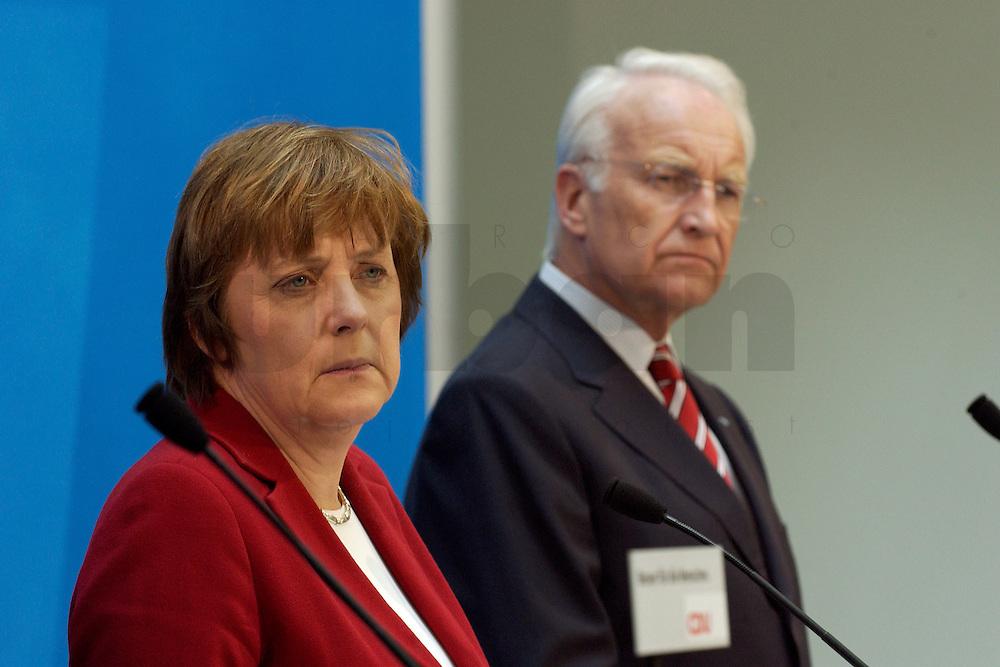 02 APR 2004, BERLIN/GERMANY:<br /> Angela Merkel (L), CDU Bundesvorsitzende, und Edmund Stoiber (R), CSU, Ministerpraesident Bayern, waehrend einem Pressestatement zu dem vorangegangenem europapolitischen Spitzengespraech von CDU und CSU, Konrad-Adenauer-Haus<br /> IMAGE: 20040402-02-014<br /> KEYWORDS: Ministerpr&auml;sident, CDU Bundesgeschaeftsstelle