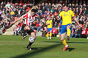 Dan Holman and Terry Hawkridge during the Vanarama National League match between Cheltenham Town and Lincoln City at Whaddon Road, Cheltenham, England on 30 April 2016. Photo by Antony Thompson.