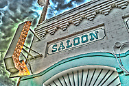 HDR photograph of a classic old world saloon sign. The Frenchman and Me , Wolf Creek Montanana