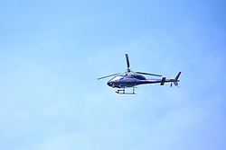 March 17, 2019 - Christchurch, New Zealand - A police helicopter circles the Christchurch District Court overhead as it does surveilance of the surrounding area where the suspected shooter appeared in Christchurch on March 16, 2019. At least 49 people have died in the Christchurch mosque shooting, the worst terror attack in New Zealand history. The national security threat level has been increased from low to high for the first time in New Zealand's history after this attack. (Credit Image: © Sanka Vidanagama/NurPhoto via ZUMA Press)