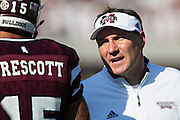 STARKVILLE, MS - SEPTEMBER 19:  Head Coach Dan Mullen and Dak Prescott #15 of the Mississippi State Bulldogs talk during a timeout against the Northwestern State Demons at Davis Wade Stadium on September 19, 2015 in Starkville, Mississippi.  The Bulldogs defeated the Demons 62-13.  (Photo by Wesley Hitt/Getty Images) *** Local Caption *** Dan Mullen; Dak Prescott