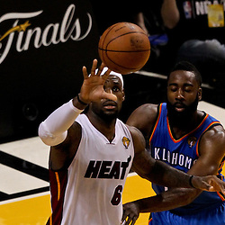 Jun 21, 2012; Miami, FL, USA; Miami Heat small forward LeBron James (6) is defended by Oklahoma City Thunder guard James Harden (13) during the third quarter in game five in the 2012 NBA Finals at the American Airlines Arena. Mandatory Credit: Derick E. Hingle-US PRESSWIRE