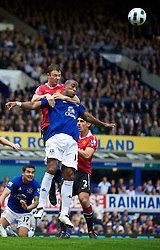 LIVERPOOL, ENGLAND - Saturday, September 11, 2010: Everton's Sylvain Distin and Manchester United's Jonathan Evans during the Premiership match at Goodison Park. (Photo by David Rawcliffe/Propaganda)