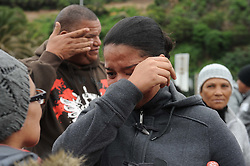 Cape Town - 180813 - The Hout Bay fishing community are distraught and tensions are running high after an alleged poacher was shot at see while being apprehended by the authorities In pic is the deceased'pregnat girlfriend, Cleo Adonis, 22 -  Photographer - Tracey Adams - ANA African News Agency