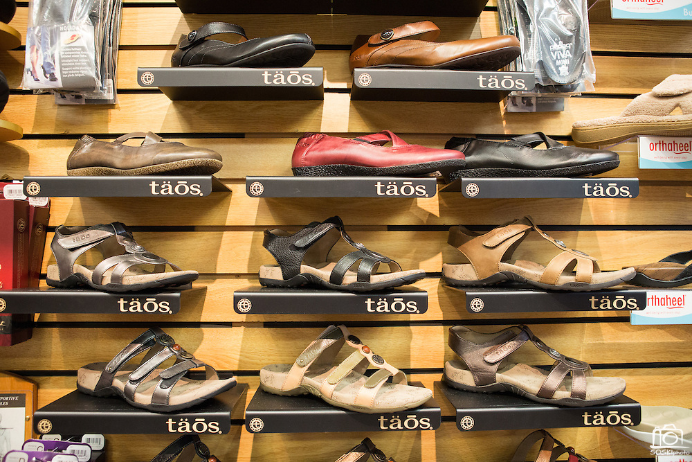 Hundreds of men's and women's shoes ranging from steel toe work books to athletic tennis shoes are displayed on the walls of Beck's Shoes in Milpitas, Calif.  Photo by Stan Olszewski/SOSKIphoto.