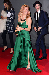 Sienna Miller with Tom Sturridge at the British Fashion Awards in London, Monday, 2nd December 2013. Picture by Nils Jorgensen / i-Images<br />