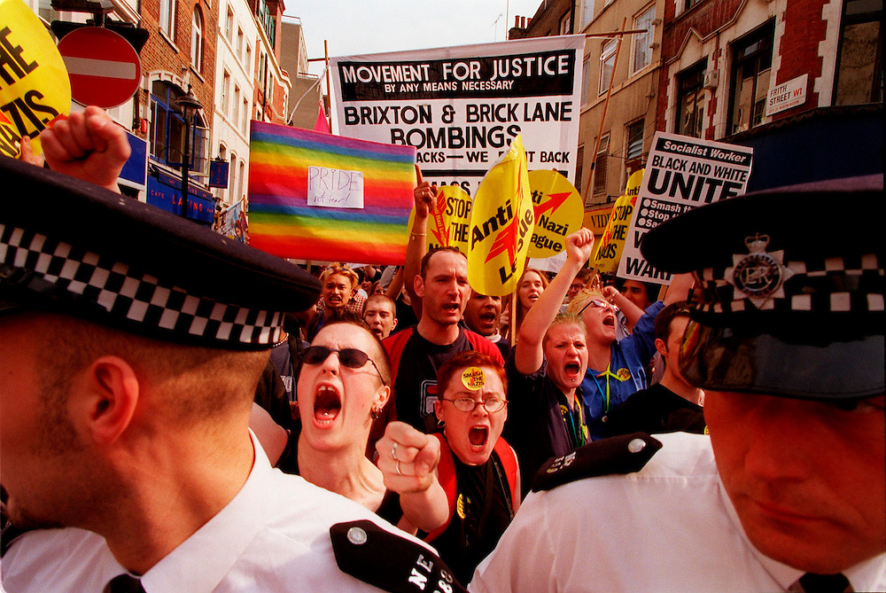Defiant anti-racist and gay rights campaigners march through Soho yesterday. They left the May Day rally in Trafalgar Square to do so.