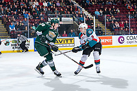 KELOWNA, CANADA - FEBRUARY 15:  Conrad Mitchell #28 of the Everett Silvertips stick checks Kaedan Korczak #6 of the Kelowna Rockets on February 15, 2019 at Prospera Place in Kelowna, British Columbia, Canada.  (Photo by Marissa Baecker/Shoot the Breeze)