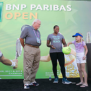 March 9, 2015, Indian Wells, California:<br /> A fan draws a chip with Taylor Townsend and Donna Vekic during the WTA Draw Ceremony at the Indian Wells Tennis Garden in Indian Wells, California Monday, March 9, 2015.<br /> (Photo by Billie Weiss/BNP Paribas Open)