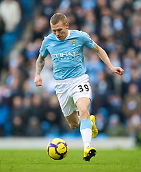 MANCHESTER, ENGLAND - Sunday, January 31, 2010: Manchester City's Craig Bellamy in action against Portsmouth during the Premiership match at the City of Manchester Stadium. (Photo by David Rawcliffe/Propaganda)